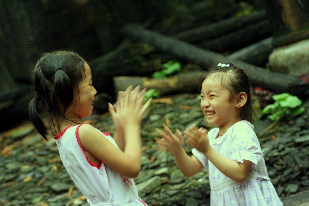 girls playing patty cake